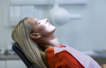 Woman Under Sedation in Dentist Chair