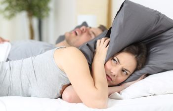 Woman Lying Awake in Bed Due to Partner's Snoring